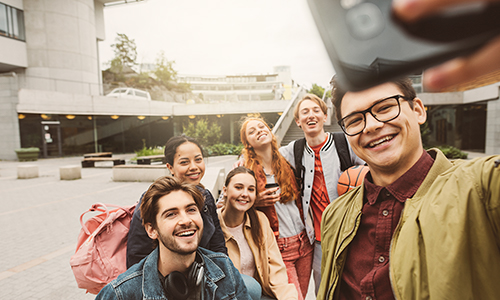 A group of students taking a group selfie